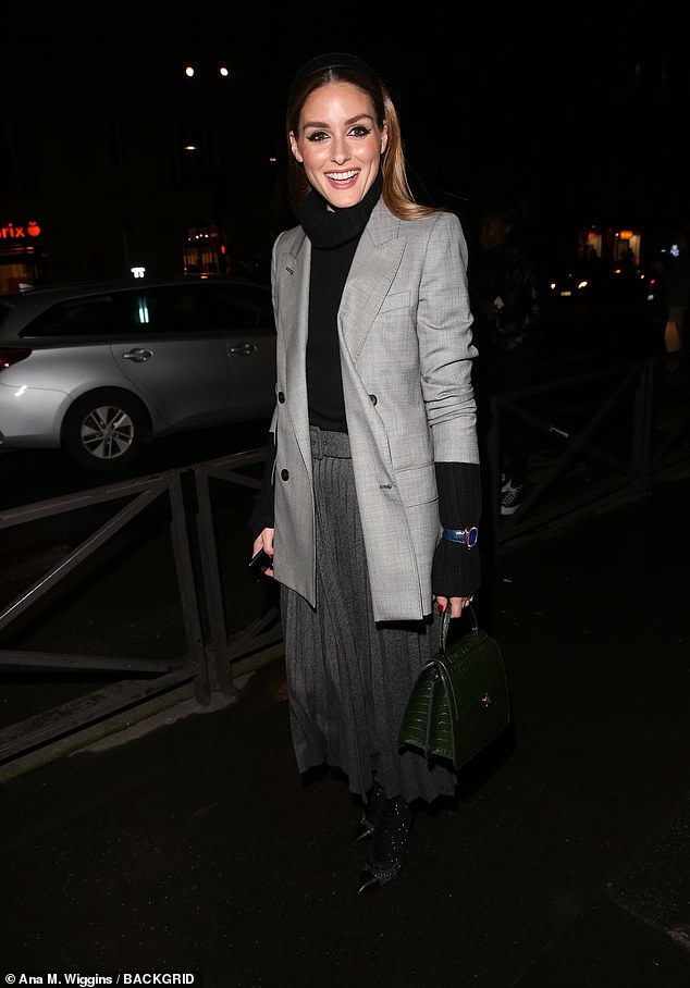 Olivia Palermo cuts a chic figure in blazer and slate grey skirt