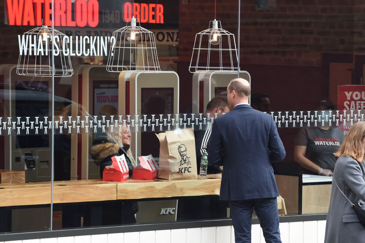 'His Royal Thighness' Prince William Caught Staring Through a KFC Window, Maybe Dreaming of Fried Chicken